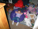 Megan looks comfortable in that messy playroom!
