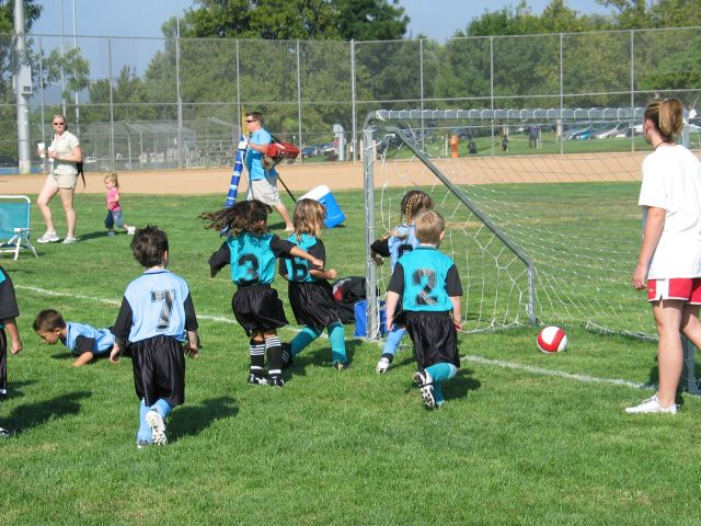 Kate (turquoise #6) scores a goal for the Bandits